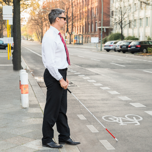 Picture of visually impaired man with white cane